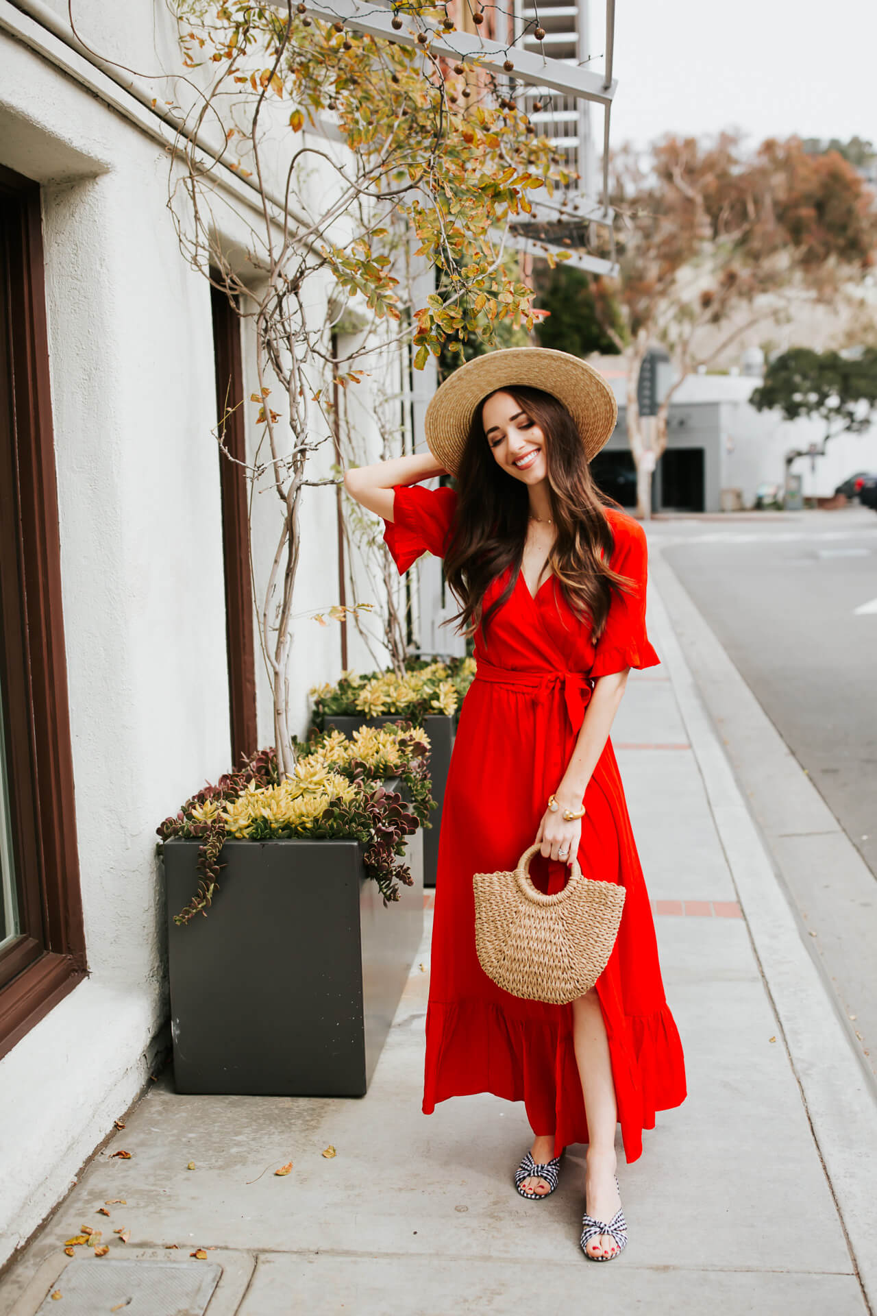 cute straw hat with red wrap dress - would be perfect as a beach coverup dress