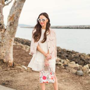 the cutest spring outfit with a white dress and floral bag