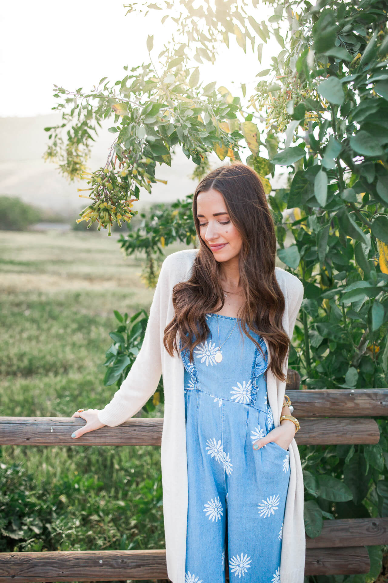 spring outfit inspiration with a chambray jumpsuit and cardigan