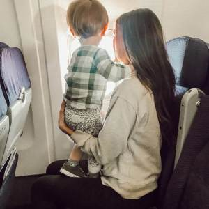 tips for your first family flight with a toddler- what to do at the airport and what to bring in your diaper bag - M Loves M