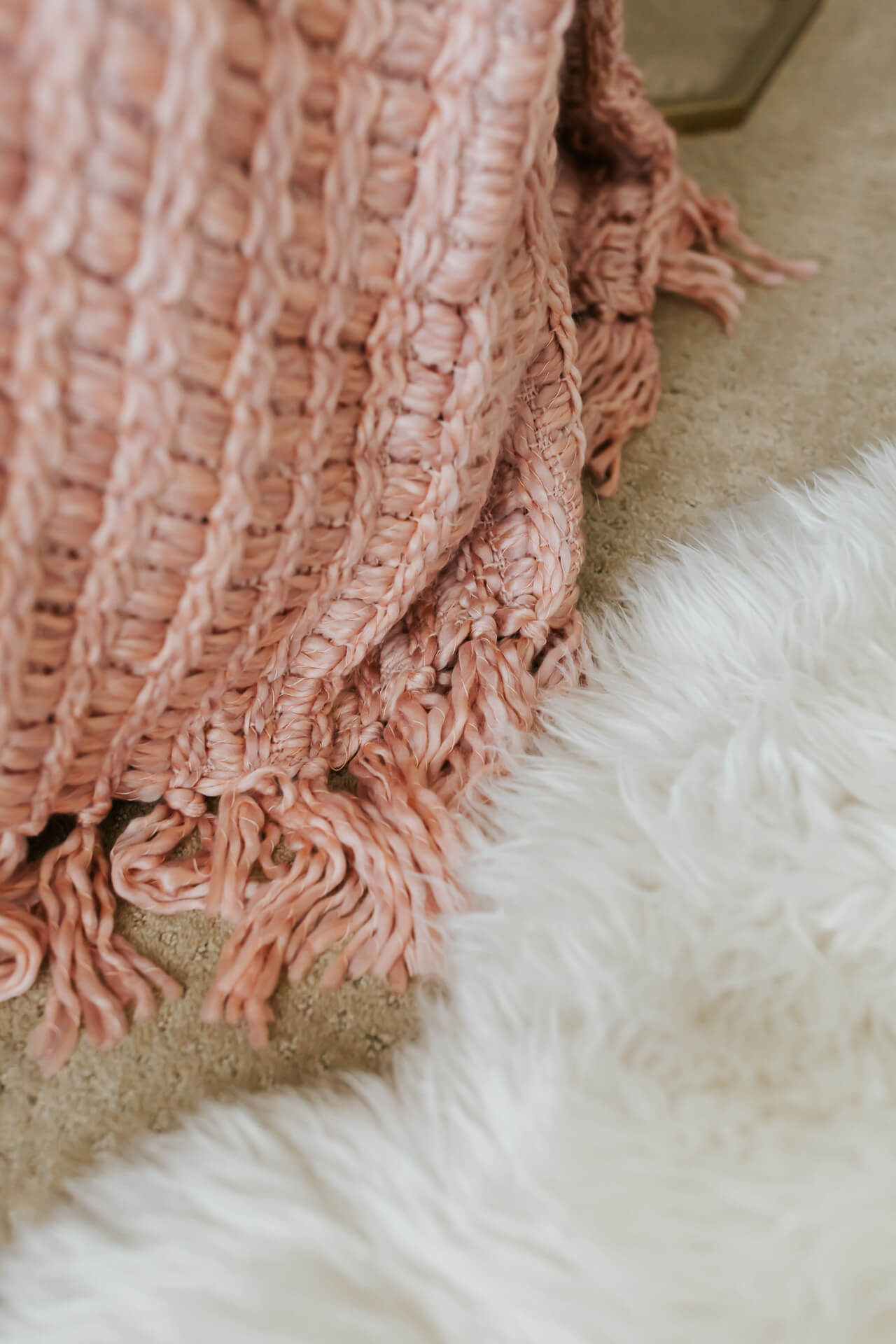 Cozy knitted blankets and sheepskins rugs make our bedroom so inviting! | M Loves M @marmar
