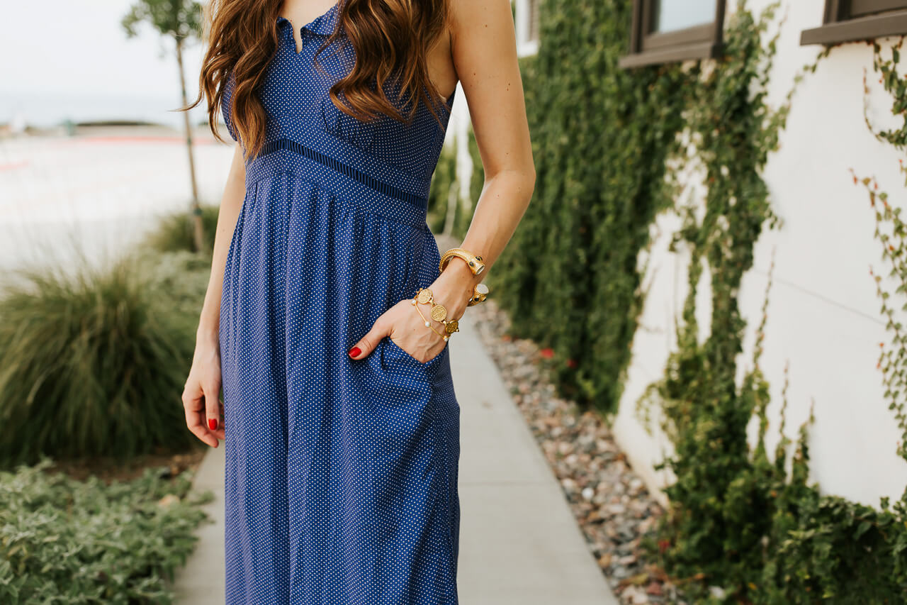 A blue jumpsuit with gold bangles and elegant accessories.   M Loves M @marmar