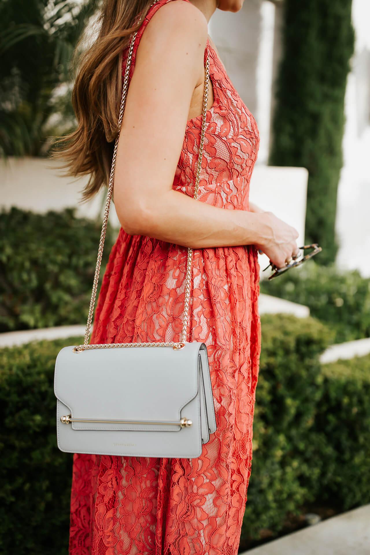 A light blue crossbody purse. | M Loves M @marmar