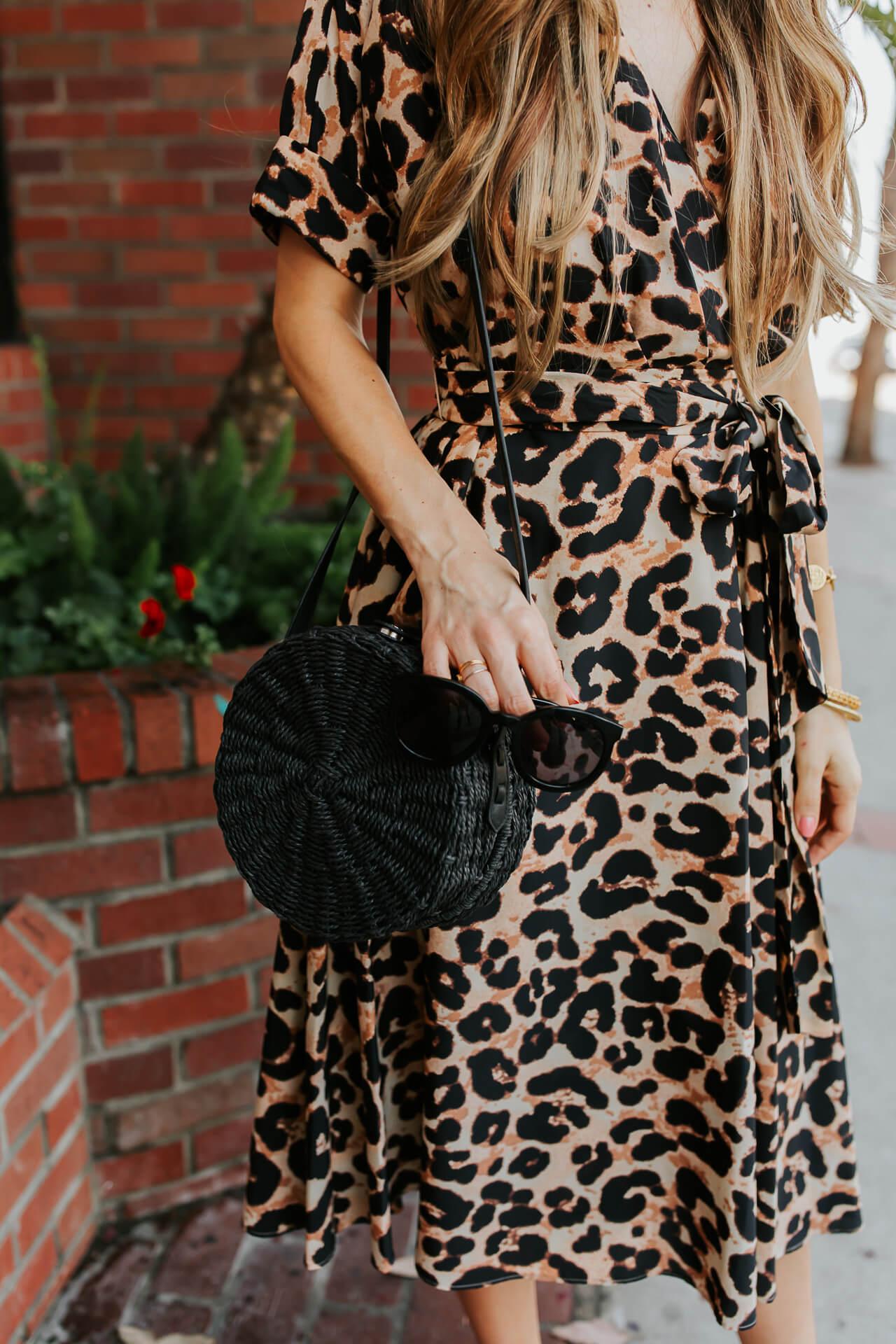 A leopard print dress and black circle bag. | M Loves M @marmar