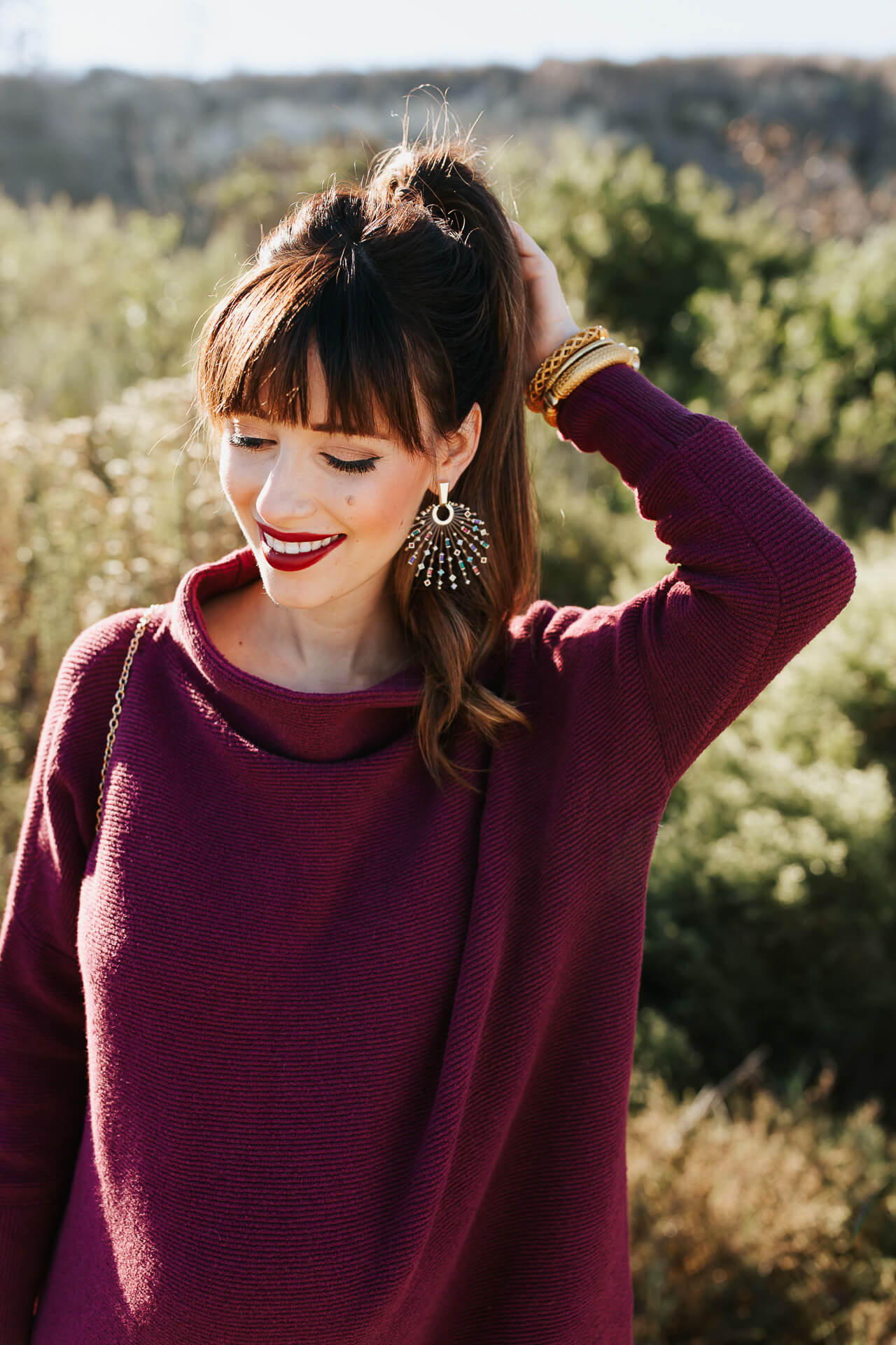 Statement earrings with a high ponytail are such a fun look! - M Loves M @marmar