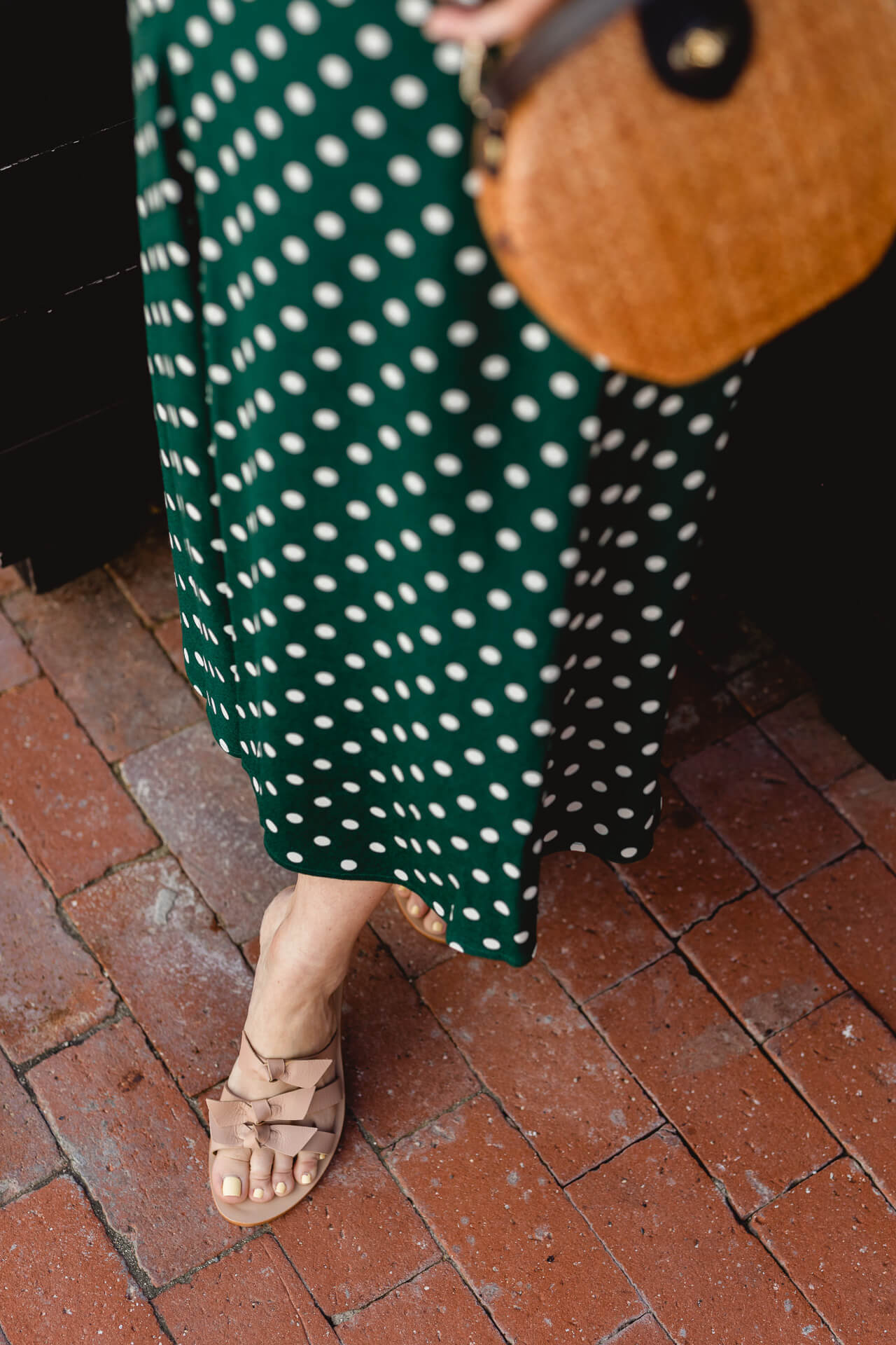 A green dot skirt from Reformation. - M Loves M