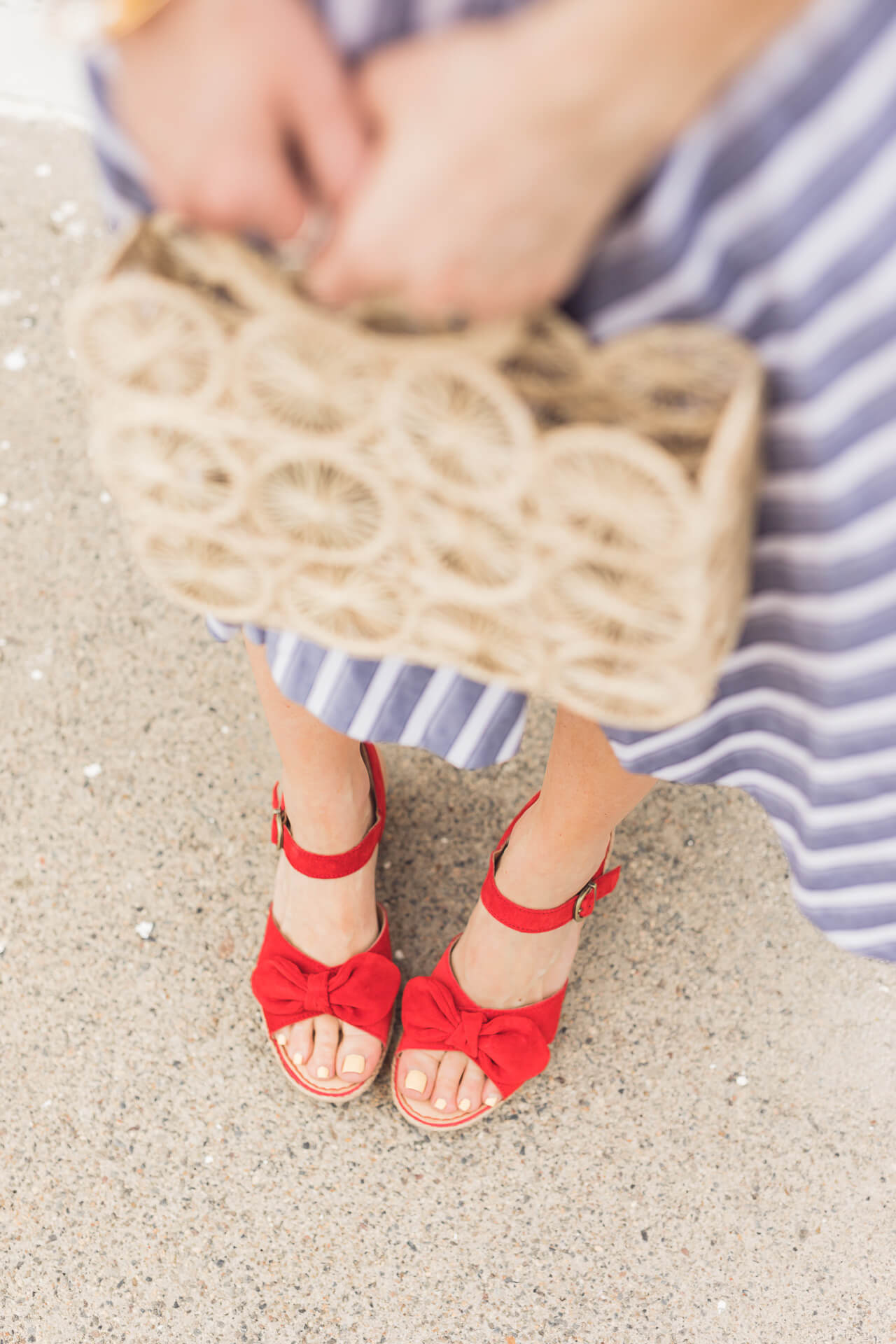 A straw bag and red shoes!- M Loves M