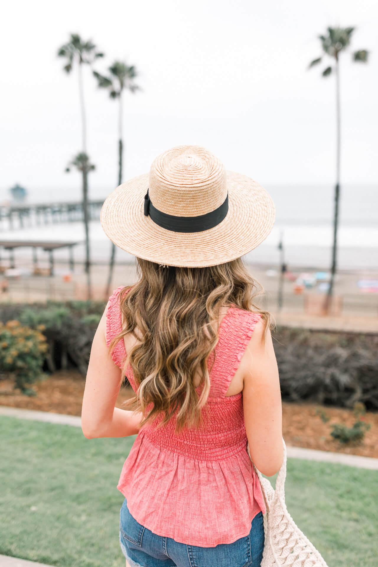 Love this cute beach sunhat with a black ribbon! - M Loves M