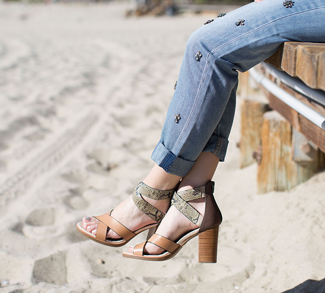tan and snakeskin sandals on the Laguna Beach boardwalk by M Loves M
