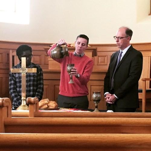 Jess Cook celebrates Communion with Rev. Annanda Barclay (left) and Rev. Scott Clark (right)