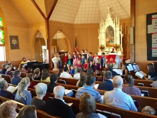 children singing in church at hymn festival