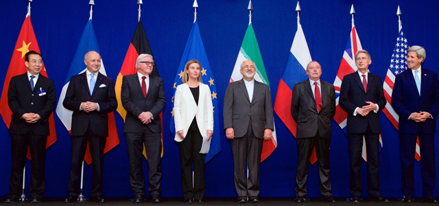 (From Left) Head of Mission of People's Republic of China to the European Union Hailong Wu, French Foreign Minister Laurent Fabius, German Foreign Minister Frank-Walter Steinmeier, European Union High Representative for Foreign Affairs and Security Policy Federica Mogherini, Iranian Foreign Minister Javad Zarifat, Russian Deputy Political Director Alexey Karpov, British Foreign Secretary Philip Hammond, and U.S. Secretary of State John Kerry following negotiations between the P5+1 member nations and Iranian officials about the future of Iran's nuclear program at the École Polytechnique Fédérale de Lausanne in Switzerland on April 2, 2015.