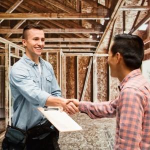 Carpenter shaking hand with customer