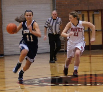 Glacier Peak Sophomore Sadie Mensing is guarded by Terrace Junior Kenzie Grayson. (Photos by David Carlos)
