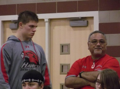 MTHS wrestler Brett Potter talks to coach Kanoe Vierra.