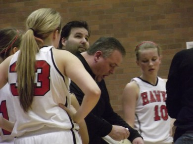 Terrace Coach Dave Brophy draws up a play during a timeout in the last minute of the game. Looking on are Nikkie Froehlich (10) Maddy Kristjanson (33).