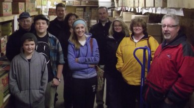 Families from the two neighborhoods in the food bank's warehouse.