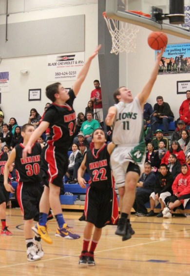 Wilson Reidt (11) led the Lions with 20 points. (Photos by Tania Fortigyn)