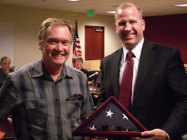 MLT Engineering Services Director Will Van Ry (on left) presented Caulfield with an American flag flown over the U.S. Capitol building on Aug. 15