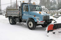 A snow plow-equipped City of Mountlake Terrace vehicle.