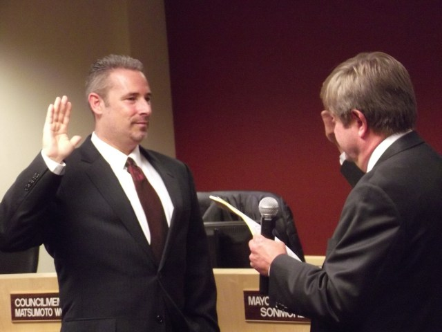 City Attorney Greg Schrag (right)administers the oath of office to recently elected MLT City Councilmember Bryan Wahl on Monday