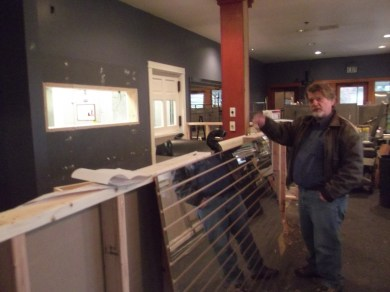 The Senior Center's Executive Director Mike Cooper in front of what will be the service counter of the dining area.
