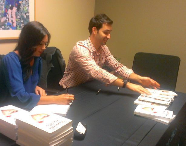 The couple signing books in Mountlake Terrace Tuesday night.