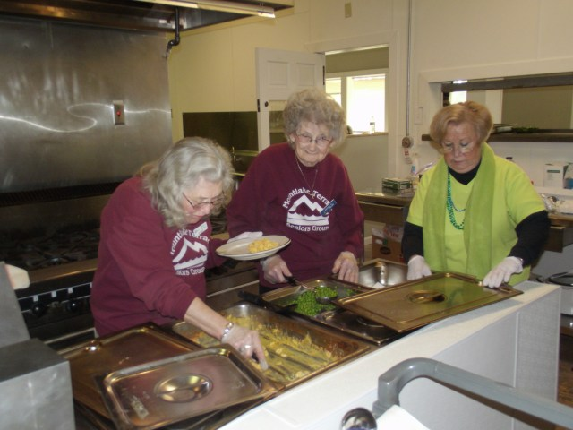 Center volunteers  serving up Friday's lunch offering, from left, are Darlene L. Johnson, Maxine Helms and Arlene Davin.