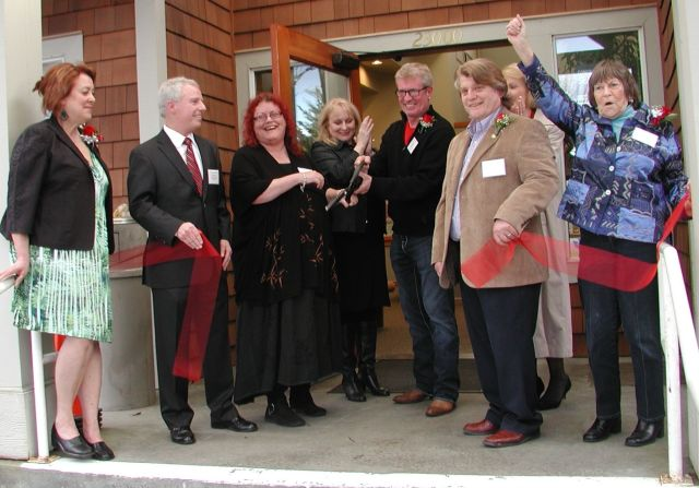 Members of the Mountlake Terrace Senior Center board celebrate after the ribbon is cut Thursday at the Ballinger Club House.
