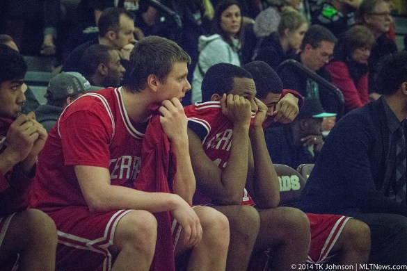 Loren and Yoel watching from the bench as the game, and their high school basketball careers, come to an end.