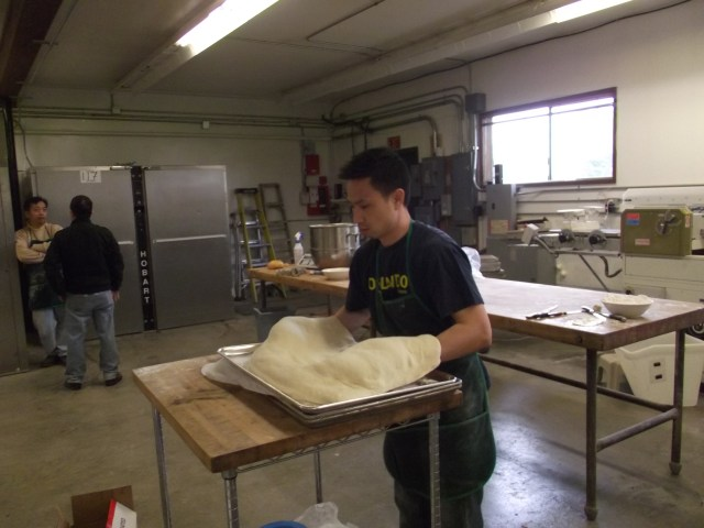 Dennis Lee, brother and business partner of owner Chris Lee, preparing croissant dough for baking.