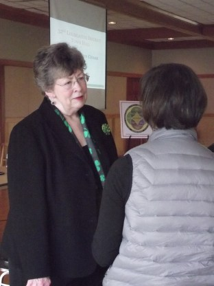 Sen. Maralyn Chase speaks with a constituent Saturday.