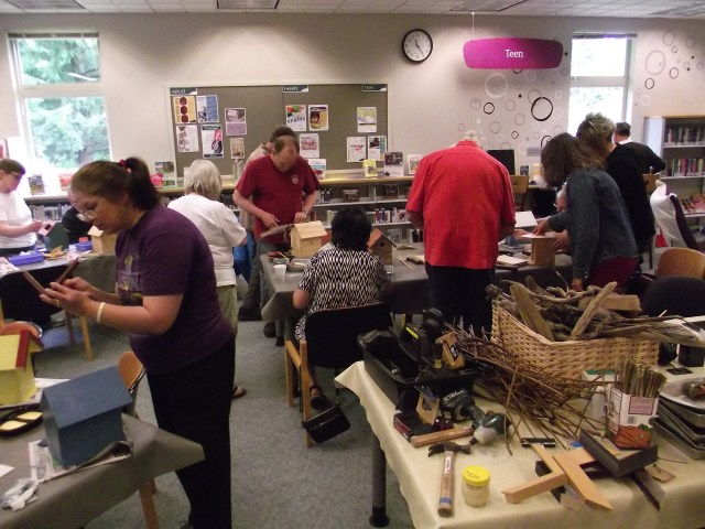Bird was the word at the Brier Library on Saturday as librarian and art and craft lover Elizabeth Koenig (not pictured) led a session of birdhouse construction for about a dozen attendees. (Photos by Doug Petrowski)