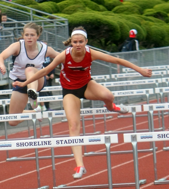 Mountlake Terrace's McKenna Hunt clears a hurdle on her way to a first place finish in the 100 hurdles finals during the 3A Northwest District 1 track and field championships Friday at Shoreline Stadium. Hunt also won the 300 hurdles.