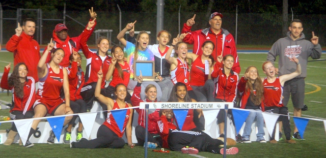 The Mountlake Terrace girls track and field team celebrates winning the 3A Northwest District 1 championship Friday at Shoreline Stadium.