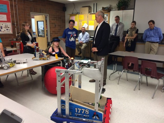 MTHS FIRST Robotics members show off their robots to Larsen.