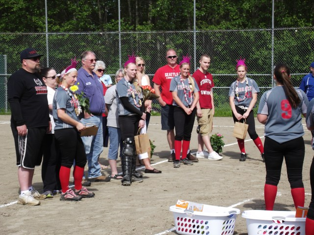 Junior Sammy Harter (No. 9) speaks to her senior teammates and their families during the pre-game ceremonies of the MTHS softball game on Monday. The four seniors are (in purple crowns, from left to right) Amanda Aversano, Hannah Baisch, Maddy Kristjanson and Megan Bruce.