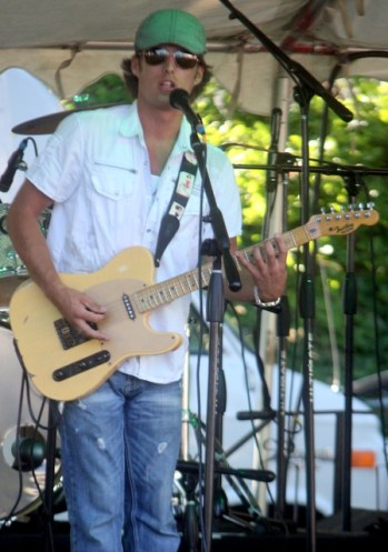 Chris Eger sings and plays guitar with his band Saturday night at Tour de Terrace.