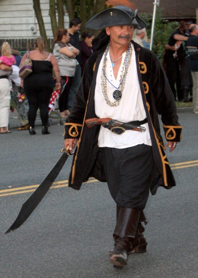 This Seafair Pirate was looking to interrogate a parade watcher.