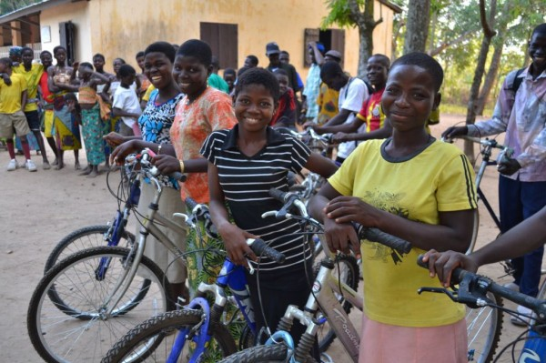 Donated bikes are put to good use — helping girls in West Africa get to school.