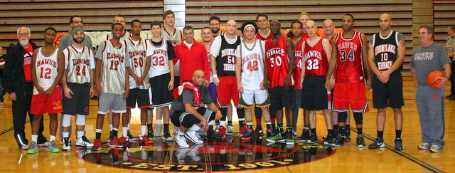Mountlake Terrace coach Nalin Sood (center/red shirt) gathers all of the alumni players at center court for a group photo shot.