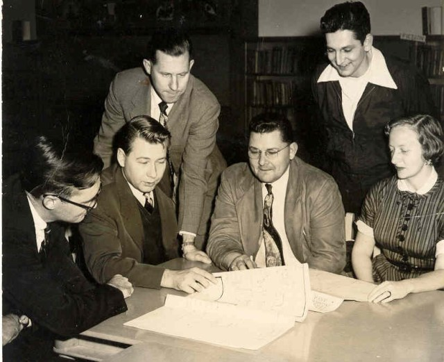 One week after the incorporation vote, the first City Council met at the original Mountlake Terrace Elementary School.  Seated (left to right) are City Attorney William Hennessey, Councilman H. Scott Wilson, Mayor Gilbert Geiser, and Councilwoman Pat Neibel. Standing are Councilmen Harley McFarland and Lester Steele.