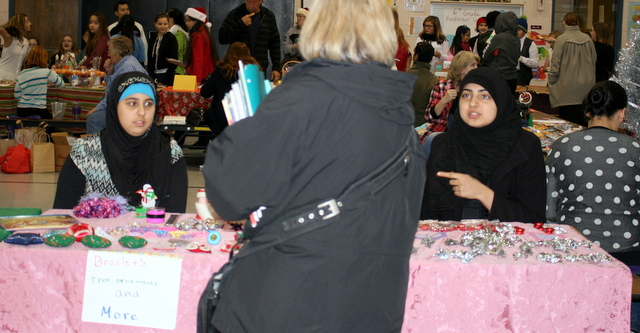 Nawal Monsour and Sarah Monsour (right) were doing brisk business at their table at the Mountlake Terrace Elementary Holiday Craft Show.