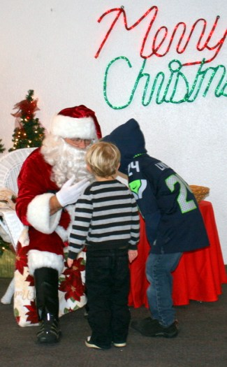 Santa Claus was a popular guy Sunday morning at the American Legion Hall.