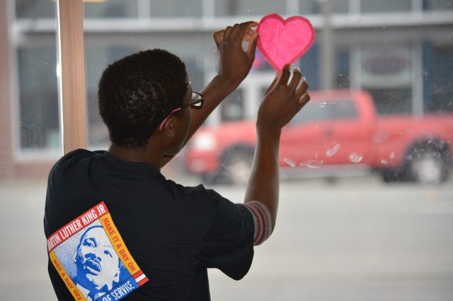 A local teen displays the Valentine he made while doing arts and crafts with participants of Full Life Care's Adult Day Health Care during MLK Day of Service in 2014. (Photo by Neil Parekh/United Way of Snohomish County)