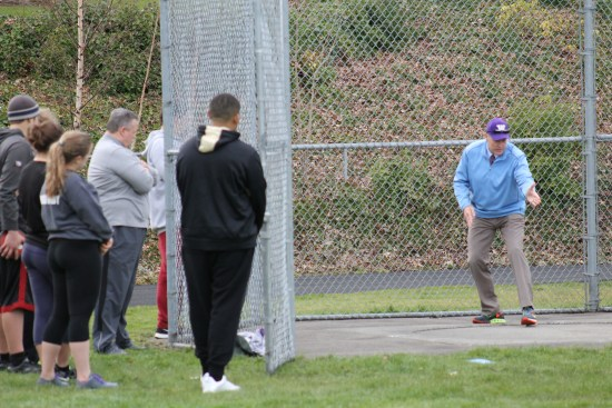 Earl, a discuss champion during his prep days at Kent-Meridian High School, taught some throwing techniques to members of the MTHS track team on Tuesday.
