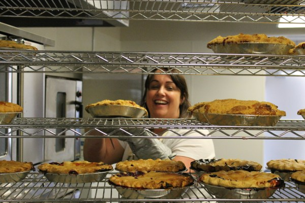 Brien places a pie on a cooling rack prior to the 1:00 grand opening of the Mountlake Terrace bakery on Saturday.