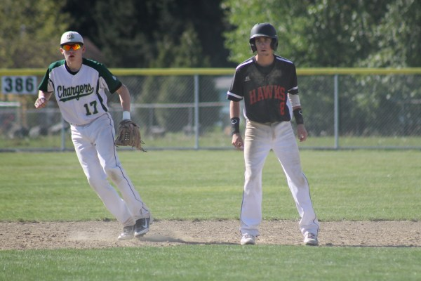 Hawk Zayn Phillips (right) takes a lead off of second base with Marysville-Getchell Charger Alex Belmont close by. (Photo by Doug Petrowski)