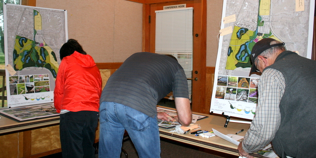 Residents leave feedback on the three preliminary plans presented by Berger Partnership.