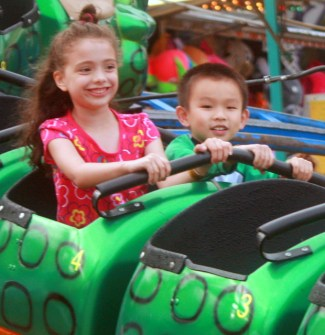 Two kids were having fun on a ride at the Tour de Terrace carnival.
